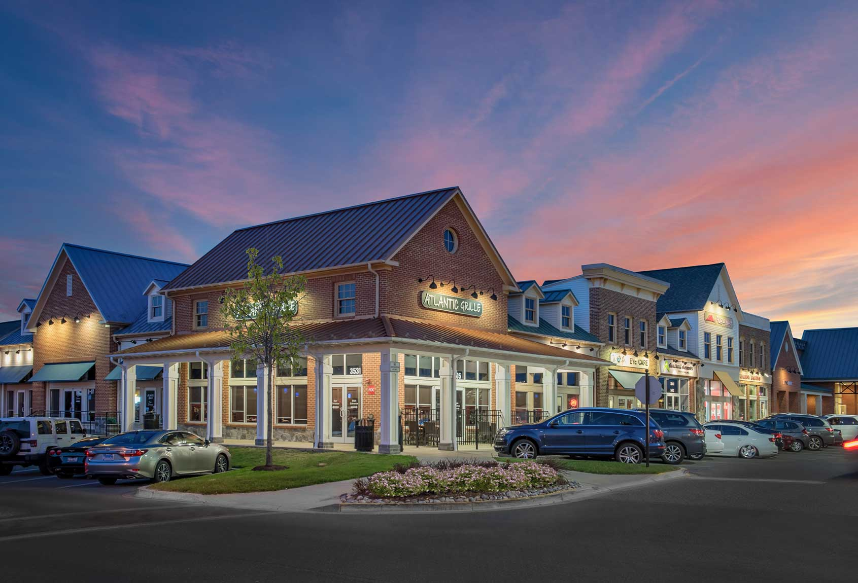 Atlantic Grille restaurant in strip mall with beautiful sky
