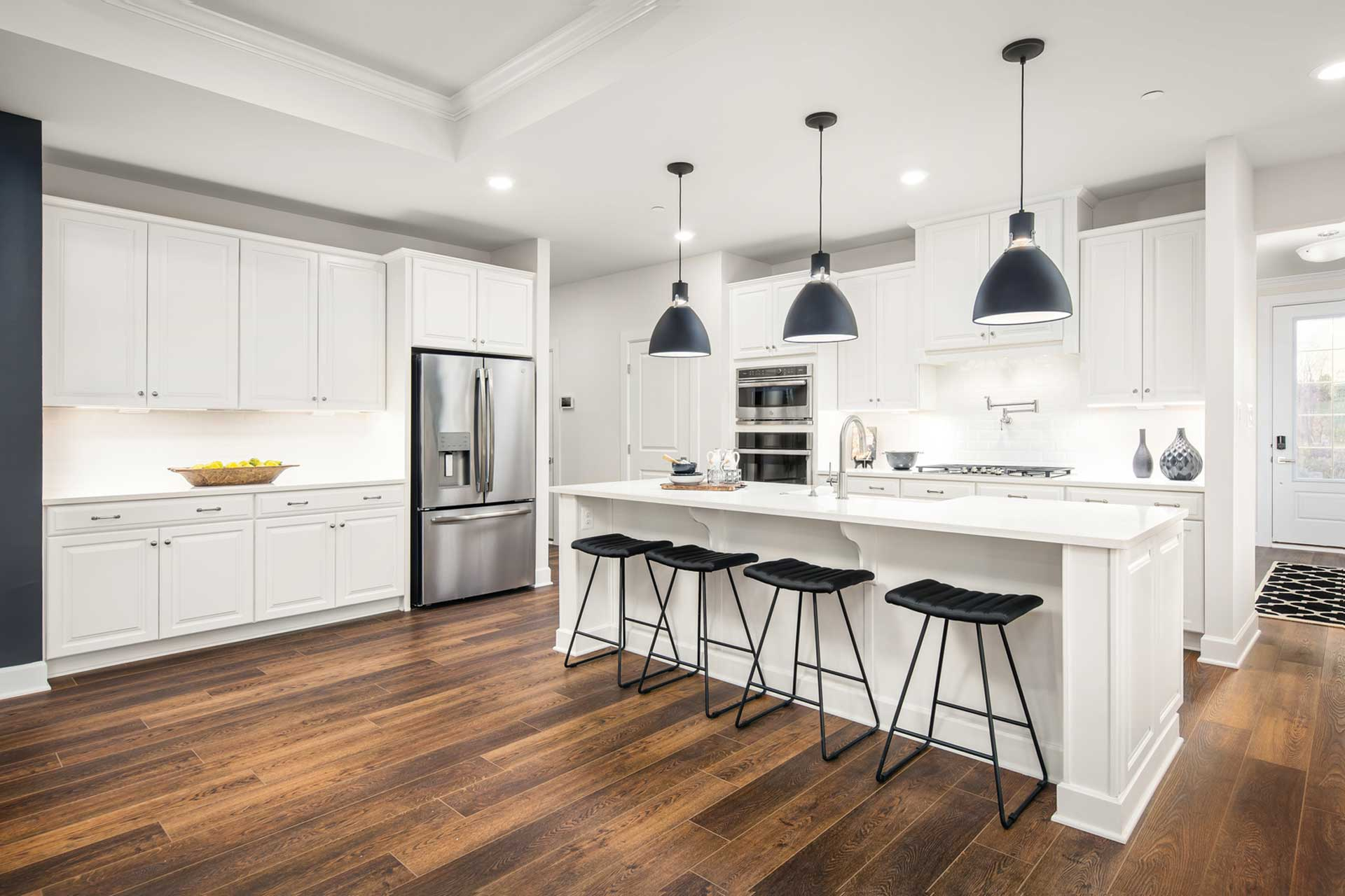 Interior of white kitchen with hardwood floors